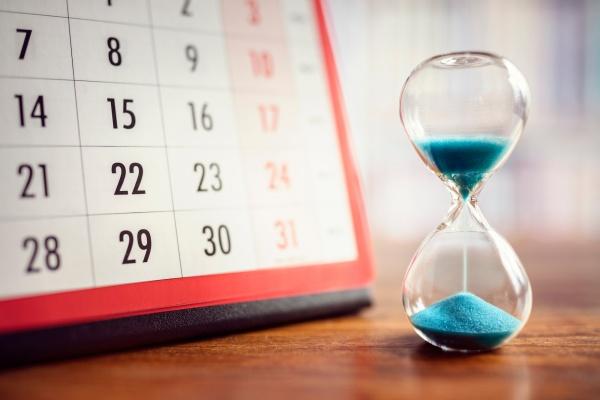 bigstock-Hour-glass-and-calendar-concep-216610957